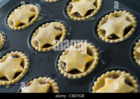 A batch of homemade mince pies ready for baking in an oven - Stock Photo