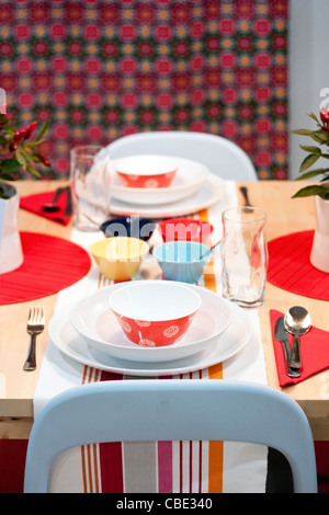 White, orange, red, yellow, turquoise and blue decorated dining table in restaurant - Stock Photo