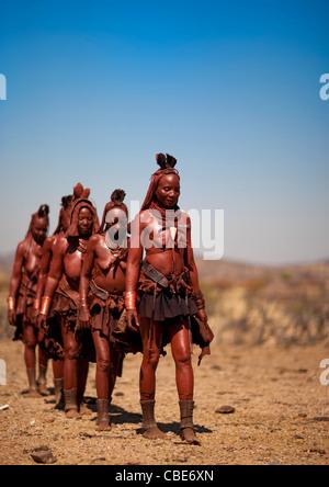 Group Of Muhimba Women Walking, Village Of Elola, Angola - Stock Photo
