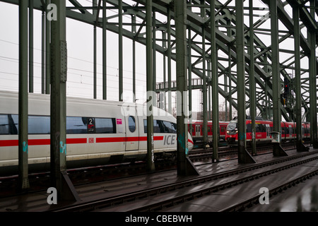 ICE and RE trains on a bridge in Cologne, Germany - Stock Photo