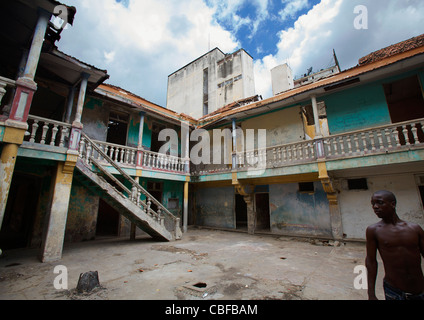 Man In The Courtyard Of The Former Grande Hotel, Now A Squat, Luanda, Angola - Stock Photo