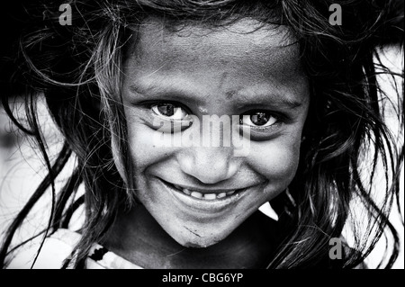 Happy young poor lower caste Indian street girl smiling. Black and White - Stock Photo