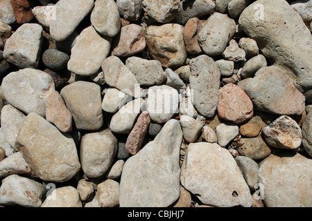 rounded gray limestone cobble background - Stock Photo