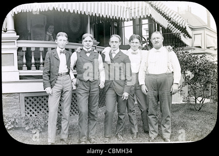 Circa 1900 antique photograph of a group of men father and sons at a family gathering. USA, possibly Ohio. - Stock Photo