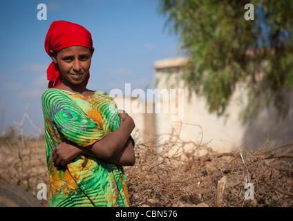 Beautiful Head And Shoulders Of Red Scarf Woman Colorful Dress Outside In Baligubadle Somaliland - Stock Photo