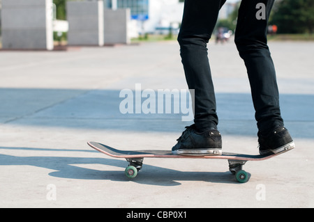 young skater perfoming stunt on his blue board - Stock Photo