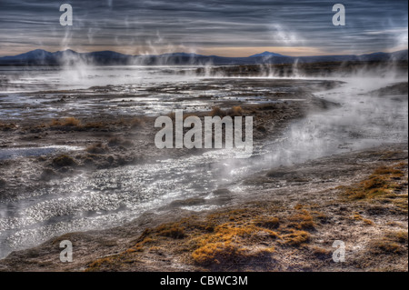 Steam rising from natural hot springs in the Salar de Uyuni, Bolivia - Stock Photo