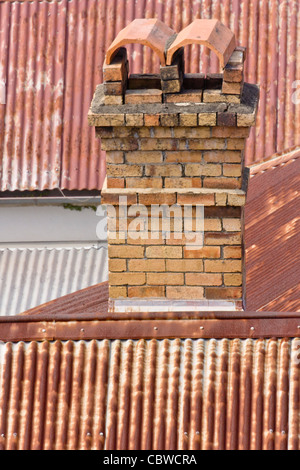 The older houses in Brisbane were usually made of timber with a brick chimney and a corrugated iron roof - Stock Photo