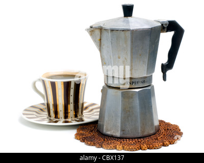 Cup full of black coffee and coffee cooker on a white background. - Stock Photo