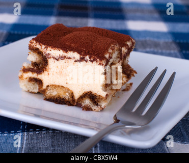 Close up portion of tiramisu on a plate - Stock Photo