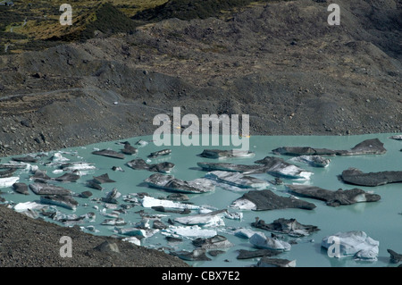 New Zealand's Mount Cook National Park includes Terminal Lake with its icebergs & the Tasman Glacier in the Mackenzie - Stock Photo