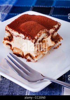 Portion of tiramisu on a plate. - Stock Photo
