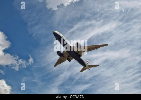 A Boeing 777 of BA - British Airways on final approach - Stock Photo