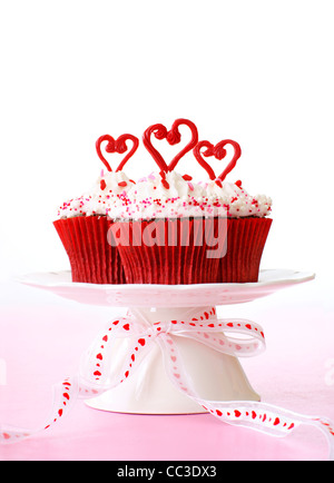 Cupcakes with vanilla frosting for Valentine's day. - Stock Photo