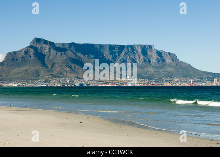 View of Table Mountain from Sunset Bay beach in South Africa. - Stock Photo