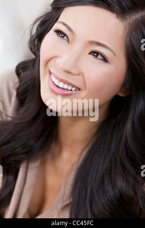 Close up portrait of a beautiful young Chinese Asian Oriental woman - Stock Photo
