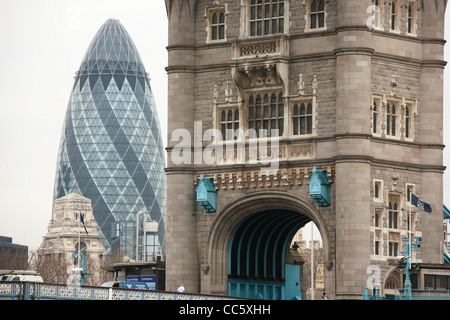 A view of London's old and new, Tower Bridge with the Gherkin Building in the distance. - Stock Photo