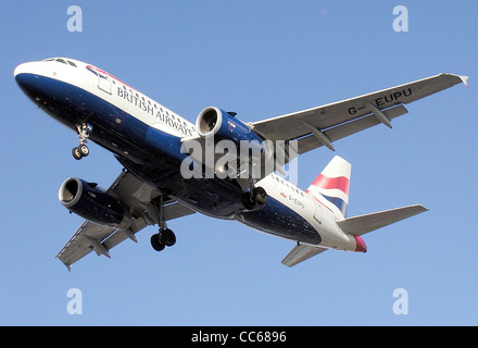 British Airways Airbus A319-100 (G-EUPU) landing at London Heathrow Airport, England. - Stock Photo