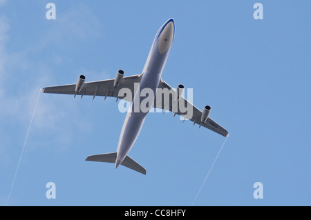 Airbus A340-300 flying overhead, London - Stock Photo
