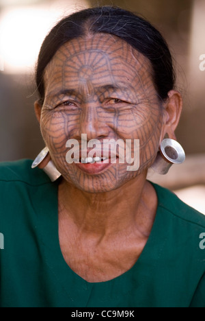 chin tribal woman with spider web design tattooed face myanmar stock photo royalty free image. Black Bedroom Furniture Sets. Home Design Ideas
