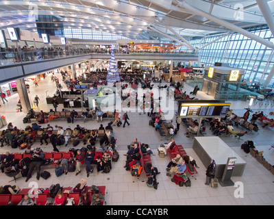 Interior of busy Terminal 5 at Heathrow Airport in London United Kingdom - Stock Photo