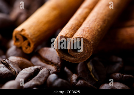 Close-up of cinnamon sticks and roasted coffee beans - Stock Photo