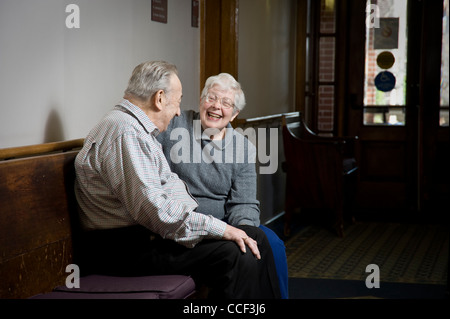 Elderly Couple Laughing Together - Stock Photo