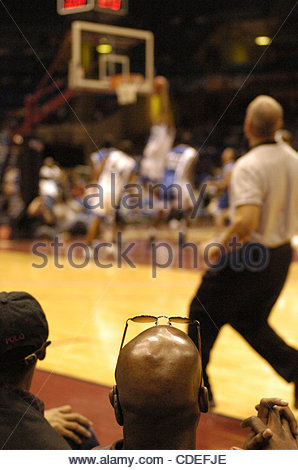 Apr. 16, 2005 - Cleveland, OH, USA - A fan watches the Black College All-Star Game from courtside at Gund Arena - Stock Photo