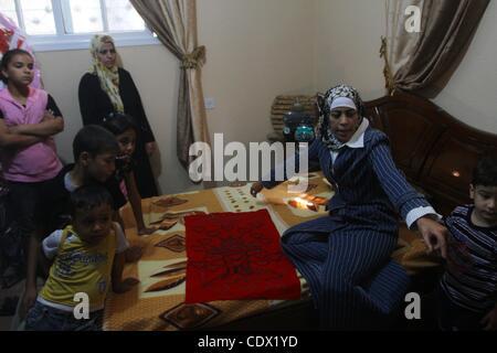 Oct. 19, 2011 - Gaza City, Gaza Strip, Palestinian Territory - Freed Palestinian prisoner Wafa Albes sits with her - Stock Photo