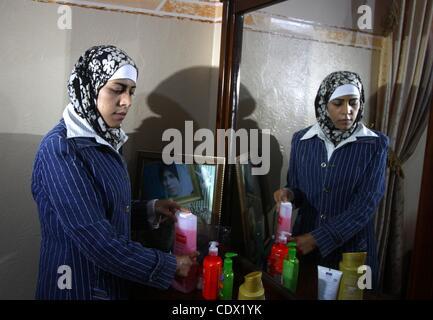 Oct. 19, 2011 - Gaza City, Gaza Strip, Palestinian Territory - Freed Palestinian prisoner Wafa Albes arranges her - Stock Photo
