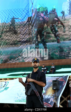 Oct. 19, 2011 - Gaza City, Gaza Strip, Palestinian Territory - Palestinian police officers sit on stage in front - Stock Photo