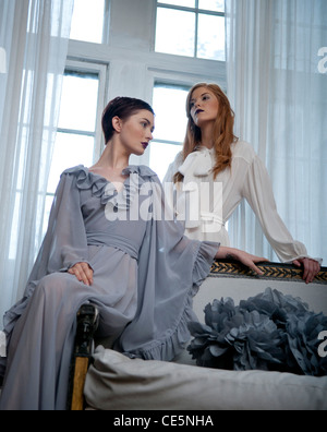 Two women in front of a window - Stock Photo
