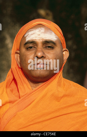 RVA 83079 : indian hindu sanyasi priest face portrait in saffron robe forehead sandlewood paste india - Stock Photo