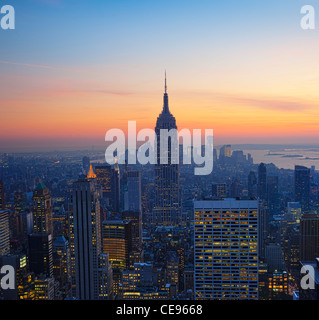 Empire State Building at Sunset from Top of the Rock Observatory - Stock Photo