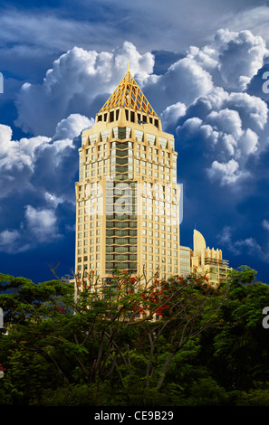Golden high rise building against the blue sky - Stock Photo