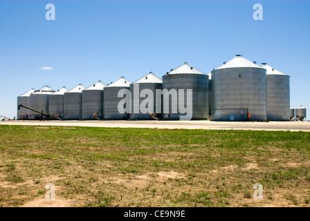Corrugated Iron Silos near a railway siding in Southern New South Wales, Australia - Stock Photo