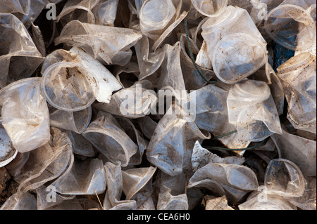Discarded plastic tea cups in the Indian countryside - Stock Photo