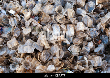 Discarded plastic tea cups in the Indian countryside. Andhra Pradesh, India - Stock Photo