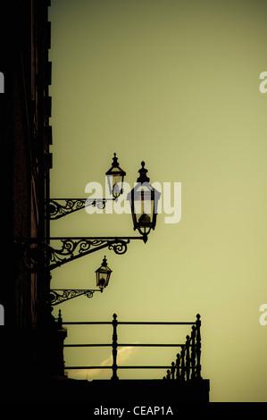 Old-Fashioned Street Lights on building, Stockholm, Sweden - Stock Photo