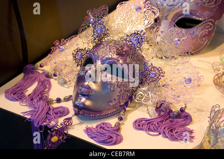 Venice, Veneto, Italy. Typical carnival masks on display in shop window. - Stock Photo