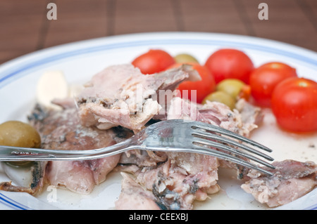 Mackerel with some fresh vegetables on a white plate, close up image - Stock Photo