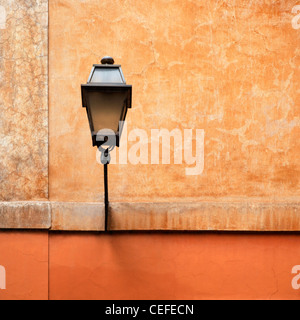 Streetlight attached to wall - Stock Photo