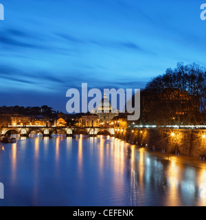 St Peter's Basilica lit up at night - Stock Photo