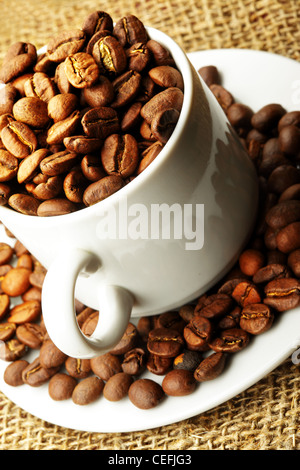 Cup full of coffee beans close up - Stock Photo