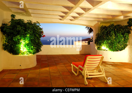 The sea view from a terrace of luxury hotel, beach and Atlantic Ocean at sunset, Tenerife island, Spain - Stock Photo