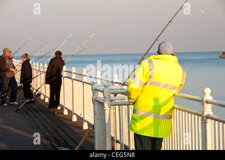Fisherman sea fishing at Wearmouth in Sunderland, UK. - Stock Photo