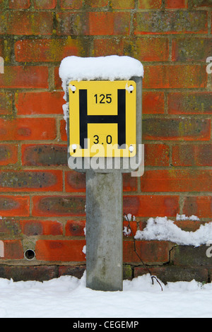 fire hydrant sign on street covered in snow - Stock Photo