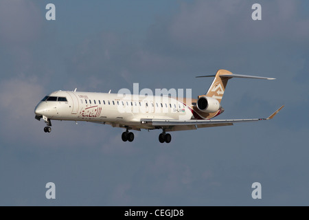 Libyan Airlines Bombardier CRJ900 with the post-revolutionary flag on the rear fuselage - Stock Photo
