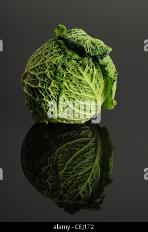 Green Lettuce isolated on a reflective gray surface - Stock Photo