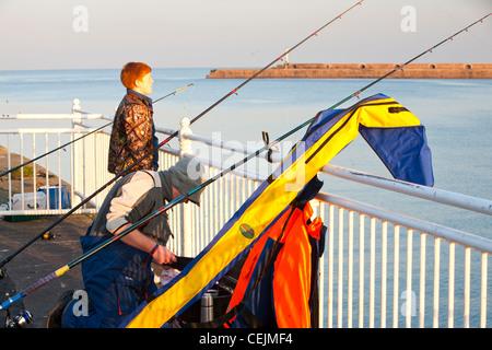 Fisherman sea fishing at Wearmouth in Sunderland, UK. - Stock Photo